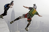 98 base jumpers take part in 400m plunge off Malaysian tower